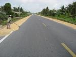 Drying rice on asphalt
