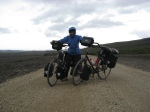 Soraya catching wind and holding bikes in the Icelandic interior